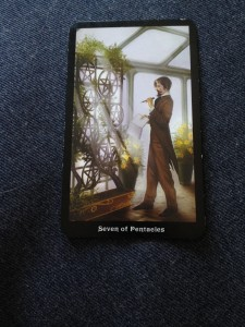 7 of Pentacles from the Steampunk Tarot by Barbara Moore.