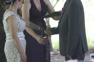 In this picture, I am blessing the handfasting cords with the Spirit of Fire. This was taken at Hilary Parry Haggerty and Dave Haggerty's wedding!