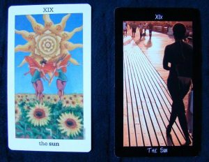 Left, Sun and Moon Tarot by Vanessa Decout. Right, Tarot of the Boroughs (!!!). Photo courtesy of Divine Whispers.Net